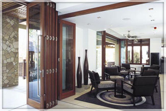 Folding doors folding doors glass exterior for Large folding patio doors