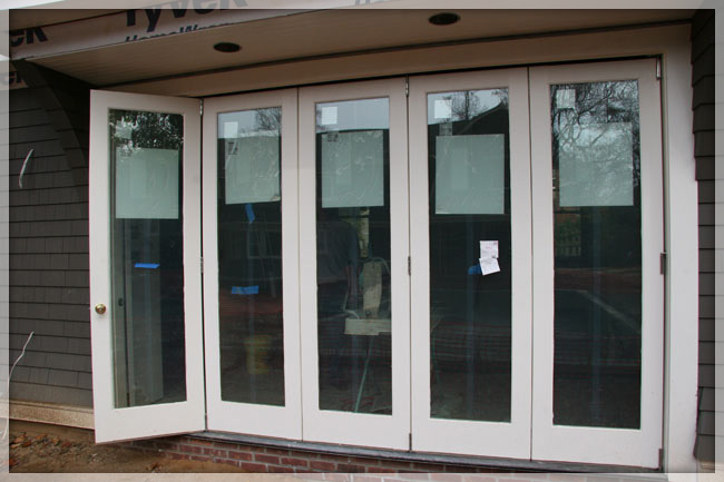 Folding patio doors exterior folding doors riviera for Residential front doors with glass